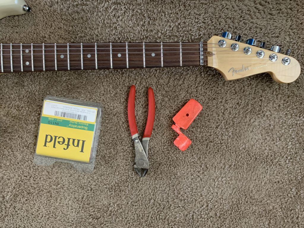 Guitar, strings, and tools
