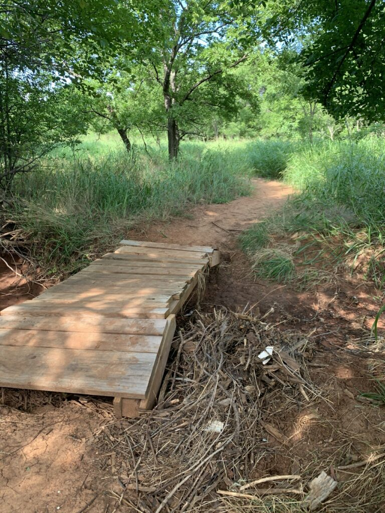 Trail with wooden bridge
